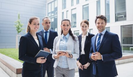 Portrait of confident businesspeople standing outside office building